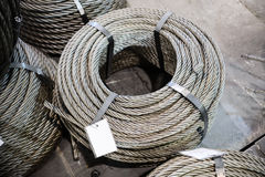 Coils of steel cable. Several steel wire rope rings stacked on the floor Stock Image