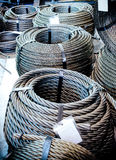 Coils of steel cable. Several steel wire rope rings stacked on the floor Royalty Free Stock Photo
