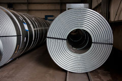 Coils at store. Rows of steel plate coils stock photo