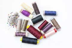 Coils of Thread and Pins, Sewing Items for Tailor Craft on White Background.  royalty free stock photography