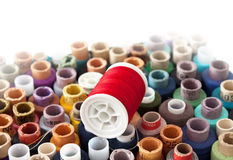Coils with threads. Coils with multi-coloured threads for sewing are packed in a box Stock Photography
