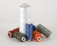 Coils with threads. For sewing machines, fashion royalty free stock images