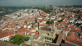 Coimbra Cathedral aerial. Coimbra panorama from top of bell Clock Tower. Old Coimbra Cathedral with dome and cloister. Se Velha de Coimbra, is one of most stock video footage