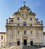 Coimbra, Portugal, August 13, 2018: Facade of the new Cathedral of Coimbra in Baroque Mannerist style seen from the street called. Student fair Stock Images