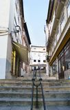 Coimbra, Portugal, August 13, 2018: Street called quebra costas bankruptcy backs in the old part of the city with many flights o. F stairs and shops and typical stock photo