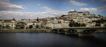 Coimbra, Portugal with the Europe Bridge. Over the Mondego River in the foreground Stock Images