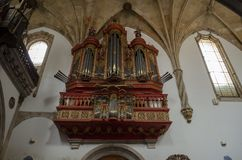Baroque pipe organ of the 18th century inside the Monastery of S. Coimbra, Portugal - July 2014: Baroque pipe organ of the 18th century inside the Monastery of royalty free stock photos