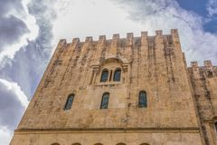 Coimbra / Portugal - 04 04 2019 : View of lateral facade of the gothic building of Coimbra Cathedral, Coimbra city and sky as. Background, Portugal architecture royalty free stock photography