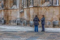 View of tourists talking on exterior close to the Gothic exterior facade of the Monastery of Batalha, Mosteiro da Batalha, royalty free stock photos