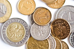 Coin. Close-up of an uncirculated polish currency coins on white royalty free stock image