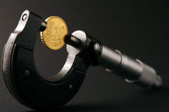 Coin. And micrometer Stock Photography