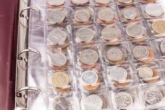 Coin album with coins Royalty Free Stock Photos