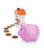 Coin bank and house Royalty Free Stock Photography