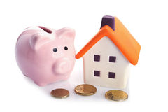 Coin bank and house stock photography