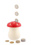 Coin-bank for savings. Lot of coins pouring into 'coin bank Royalty Free Stock Photography