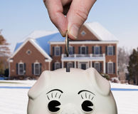 Saving money in piggy bank with fingers Stock Photography