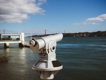 Coin binocular on seafront with beautiful view Lisbon Portugal royalty free stock images