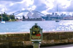Coin binocular on seafront of city royalty free stock photos