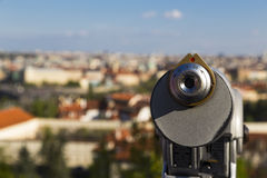 Coin binoculars. Old coin binoculars over the Prague city Royalty Free Stock Image