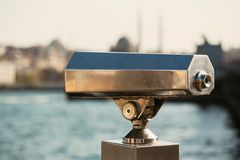 Coin binoculars viewer near the waterfront overlooking the bay and the city stock images