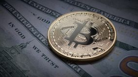Coin bitcoin on the background of a pile of dollar bills as underground economy Royalty Free Stock Images