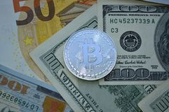 Coin Bitcoin on banknotes royalty free stock photography