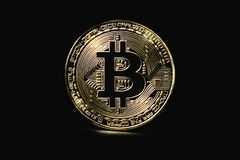 Coin bitcoin on a black background, concept finance, investments Stock Images
