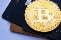 Coin bitcoin and credit cards. The concept of crypto currency. Money online stock photography