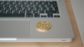 Coin bitcoin falls to the keyboard on the laptop. the concept of trading cryptocurrency. The rapid growth of the stock video footage