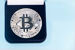 Coin bitcoin in a gift box for a ring or jewelry. The concept of crypto currency. The best gift for the holiday. A gift in Christm Stock Photos
