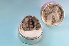 Coin bitcoin in a gift box for a ring or jewelry. The concept of crypto currency. The best gift for the holiday. A gift in Christm Stock Image