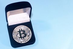 Coin bitcoin in a gift box for a ring or jewelry. The concept of crypto currency. The best gift for the holiday. A gift in Christm Stock Photography