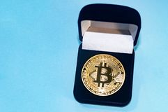 Coin bitcoin in a gift box for a ring or jewelry. The concept of crypto currency. The best gift for the holiday. A gift in Christm Stock Photo