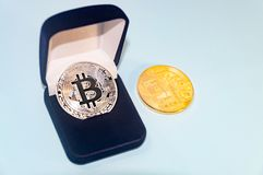 Coin bitcoin in a gift box for a ring or jewelry. The concept of crypto currency. The best gift for the holiday. A gift in Christm Royalty Free Stock Photos