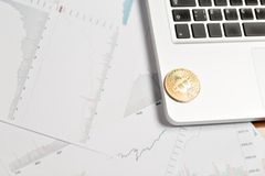 Coin bitcoin on the laptop keyboard. the concept of trading cryptocurrency. The rapid growth of the currency. Royalty Free Stock Image