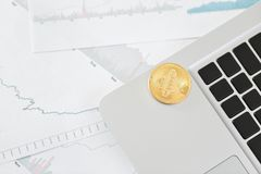 Coin bitcoin on the laptop keyboard. the concept of trading cryptocurrency. The rapid growth of the currency. Royalty Free Stock Photo