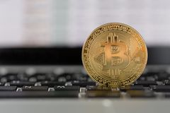 Coin bitcoin on the laptop keyboard. the concept of trading cryptocurrency. The rapid growth of the currency. Stock Photos