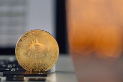 Coin bitcoin on the laptop keyboard. the concept of trading cryptocurrency. The rapid growth of the currency. Stock Image