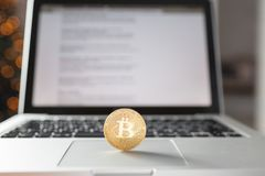 Coin bitcoin on the laptop keyboard. the concept of trading cryptocurrency. The rapid growth of the currency. Stock Photo