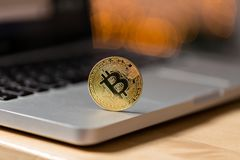 Coin bitcoin on the laptop keyboard. the concept of trading cryptocurrency. The rapid growth of the currency. Royalty Free Stock Photos