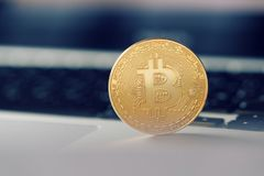 Coin bitcoin on the laptop keyboard. the concept of trading cryptocurrency. The rapid growth of the currency. Stock Photography