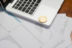 Coin bitcoin on the laptop keyboard. the concept of trading cryptocurrency. The rapid growth of the currency. Stock Images