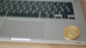 Coin bitcoin on the laptop keyboard. the concept of trading cryptocurrency. The rapid growth of the currency. spinning stock video