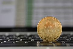 Coin bitcoin on the laptop keyboard. the concept of trading cryptocurrency. The rapid growth of the currency. Royalty Free Stock Photography