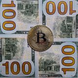 The coin of bitcoin lies on hundred-dollar banknotes. Square frame. Close-up. The coin of bitcoin lies on hundred-dollar banknotes. Close-up. Square frame royalty free stock photos