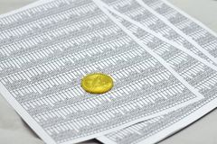 Coin bitcoin lies on sheets with numbers. Coin bitcoin lies on sheets with figures in tables. btc Royalty Free Stock Photos