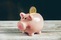 Coin box and bitcoin. Selective focus stock photo