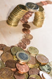 Coin bridge. Bridge build out of euro coins with cents flowing underneath it Royalty Free Stock Photography