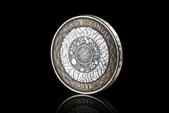 Coin. British two pound coin isolated on black background Stock Photo