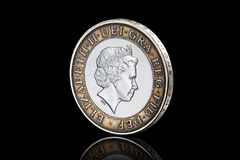 Coin. British two pound coin isolated on black background Stock Images